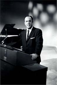 Dr. Jack standing at his pulpit